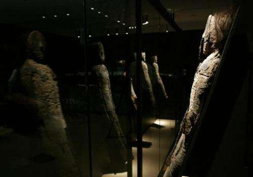 A group of Chinchorro mummies on display in the cultural centre of the La Moneda presidential palace in Santiago, on August 27,