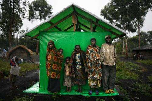 A group of pygmies shelter from the rain in Mubambiro village, on October 26, 2006 near Goma, Democratic Republic of Congo