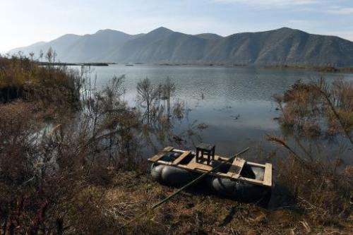 A home-made raft is seen beside an expanded section of the Danjiangkou reservoir near Jianying village in China's central Henan
