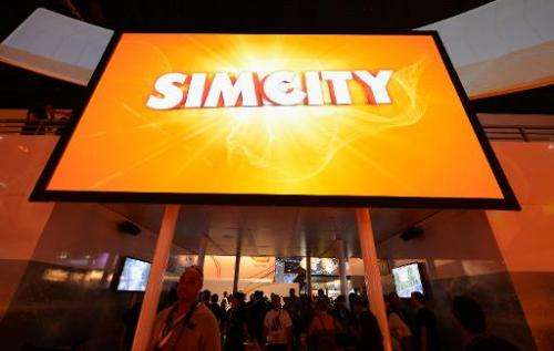 """A large screen shows the video game """"Simcity"""" at the E3 gaming conference on June 5, 2012 in Los Angeles, California"""