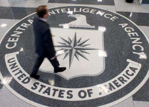 A man crosses the Central Intelligence Agency (CIA) logo in the lobby of CIA Headquarters in Langley, Virginia, on August 14, 20
