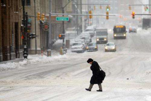 A man navigates the street as the area deals with record breaking freezing weather on January 6, 2014 in Detroit, Michigan