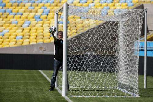A man tests the goalline technology to be used at the World Cup is pictured at Maracana Stadium in Rio de Janeiro on June 9, 201