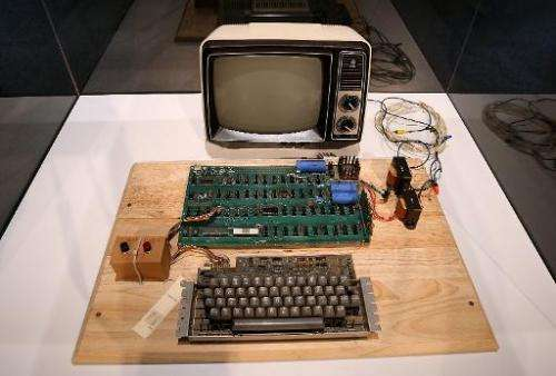 An Apple-1 computer, built in 1976, is displayed during an online auction featuring vintage tech products on June 24, 2013, in M