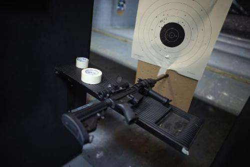 An AR-15 semi-automatic rifle is seen next to a target in an indoor gun range on April 11, 2013 in Pompano Beach, Florida