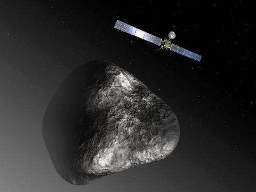 An artist impression released by the European Space Agency on December 3, 2012 of the Rosetta orbiter and the 67P/Churyumov–Gera