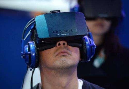 An attendee wears an Oculus Rift HD virtual reality head-mounted display at the 2014 International CES on January 9, 2014 in Las