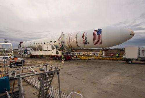 An Orbital Sciences Corporation Antares rocket is rolled out to a launchpad at NASA's Wallops Flight Facility on January 5, 2014