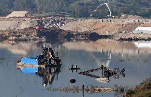 A partially-submerged factory is pictured near Jianying village in China's central Henan province on November 3, 2014