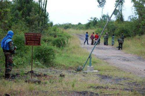A peacekeeper of the Monusco, the UN mission in DR Congo, patrolls near an entrance to Virunga National Park, on March 11, 2014