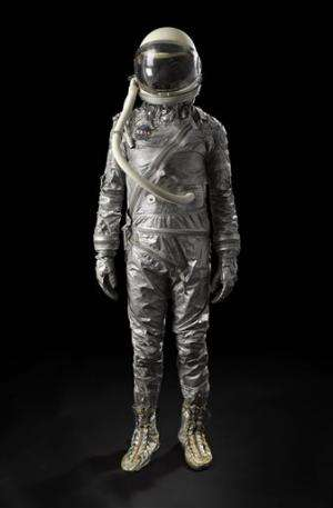 Apollo 11 checklist, spacesuit sold at NY auction