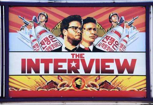 """A poster for """"The Interview""""  is displayed on the marquee of the Los Feliz 3 cinema December 25, 2014 in Los Angeles,"""