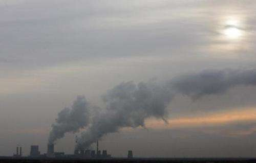 A power plant spews smoke into the evening sky on November 20, 2007 in Boxberg, Germany, contributing to fast-rising greenhouse