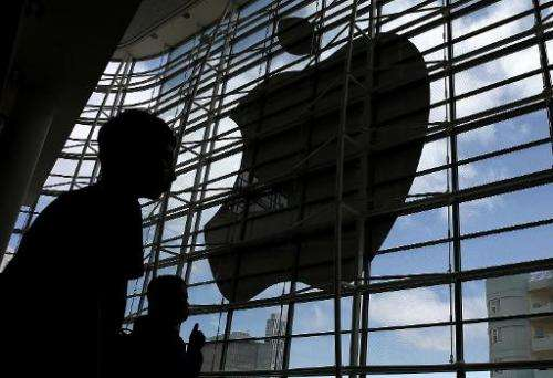 Apple said its quarterly profit rose 13 percent to $8.5 billion, as revenues jumped to $42.1 billion on strong iPhone sales