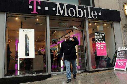 Apple's iPhone 5 is advertised in the window of a Manhattan T-Mobile store on April 12, 2013 in New York City