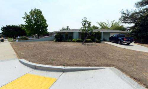 A resident's brown lawn can be seen in the city of Glendora, east of Los Angeles on July 29, 2014 in California, where a neighbo