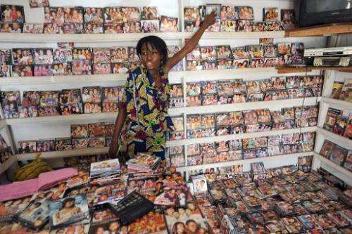 A salesgirl attends to customers in a shop at the Nigerian film market in Lagos on March 26, 2010