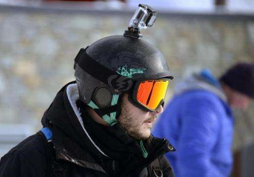 A skier carrying a GoPro camera on his helmet is pictured at Val Thorens, in the French Alps, during the ski station's opening w
