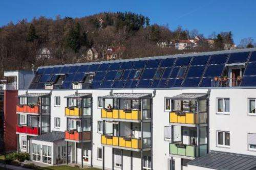A solar thermal energy system is seen on the roof of a residential complex in Ilmenau, central Germany, on February 24, 2014