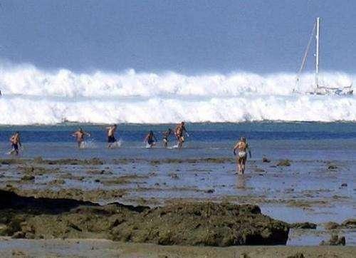 A tsunami wave rolls towards Hat Rai Lay Beach, near Krabi in southern Thailand, on December 26, 2004