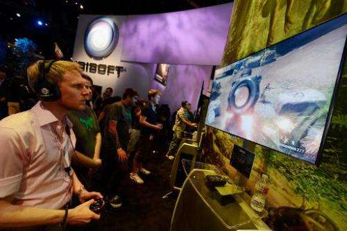 """Attendees play the video game """"Far Cry"""" in the Ubisoft booth at the E3 gaming conference on June 5, 2012 in Los Angele"""