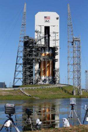 A United Launch Alliance Delta 4 rocket carrying NASA's first Orion deep space exploration craft sits on its launch pad in Cape