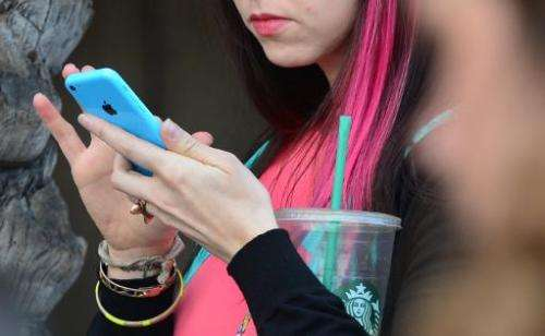 A woman uses her cellphone on January 7, 2014 in Los Angeles, California