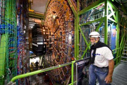 A worker walks past the Compact Muon Solenoid, a general-purpose detector at the European Organisation for Nuclear Research (CER