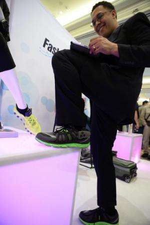 Boogio co-founder and CEO Jose Torres wears the Boogio pressure sensor insole at the 2014 International CES, January 9, 2014 in