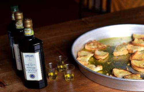 Bottles of olive oil and toasted bread with olive oil at the Buonamici Farm in Fiesole, Tuscany, on December 2, 2014