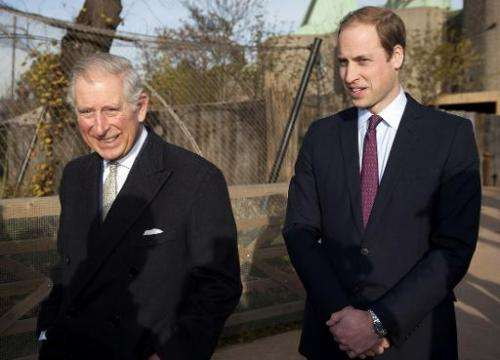Britain's Prince Charles, Prince of Wales (L), and his son Prince William, Duke of Cambridge, visit the Zoological Society of Lo