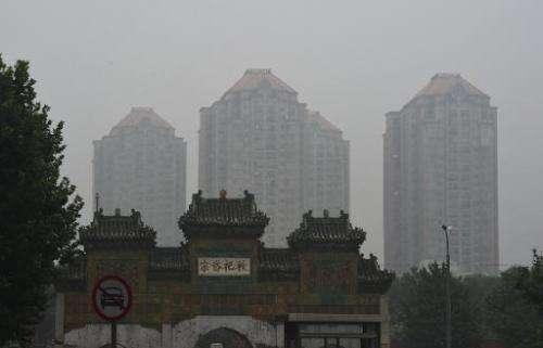 Buildings can be seen through polluted skies in Beijing, July 3, 2014 2014
