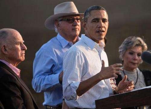 California Governor Jerry Brown (L), farmer Joe Del Bosque (2nd L) and Senator Barbara Boxer (D-CA) listen to US President Barac
