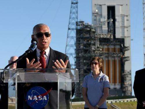 Charles F. Bolden, Jr., NASA Adminstrator, speaks to the media near the United Launch Alliance Delta 4 rocket, carrying NASA's f