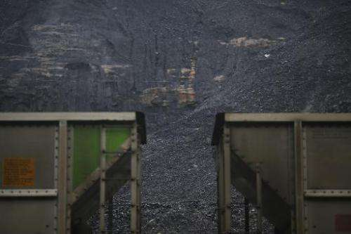 Coal harvested from a strip mine sits behind a pair of coupled coal cars on June 3, 2014 in Printer, Kentucky