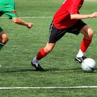 Different ball game for male and female footballers