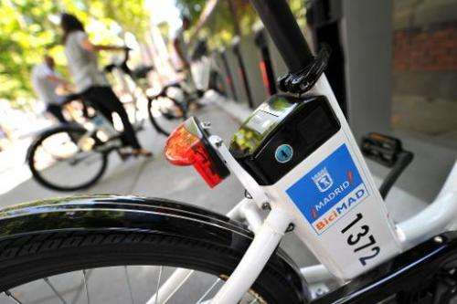 Electric bicycles are parked at a bike-sharing station in Madrid on June 23, 2014