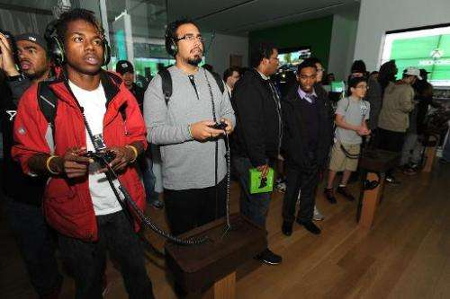 Fans play newly released Xbox One games at the Microsoft retail store at Tysons Corner Center on November 21, 2013 in McLean, Vi