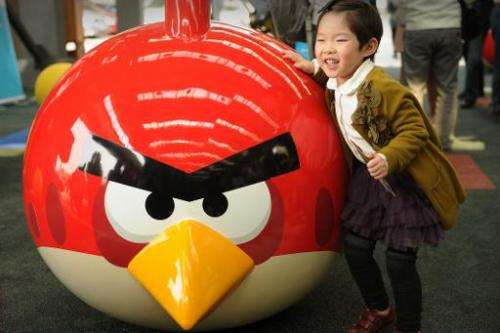 """File photo shows a young girl playing at Shanghai's first """"Angry Birds"""" Activity Park at Tongji University in Shanghai"""