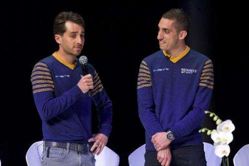 French driver Nicolas Prost (L) and Swiss driver Sebastien Buemi speak at the launch of the Formula E Championship in London on