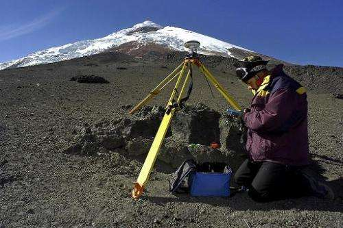 Geologist Bolivar Caceres places Differencial GPS equipment on the Cotopaxi volcano in Ecuador, on January 3, 2004