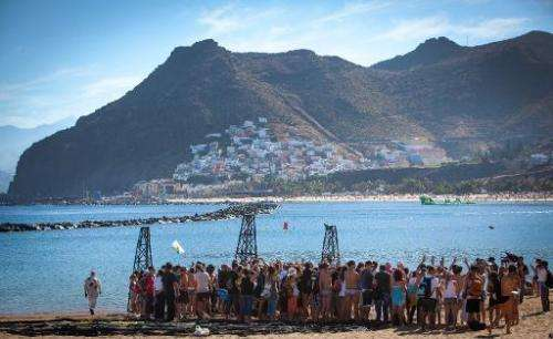 Greenpeace volunteers gather on Playa de Las Teresitas during a protest of Spain's decision to explore plans for oil and gas off