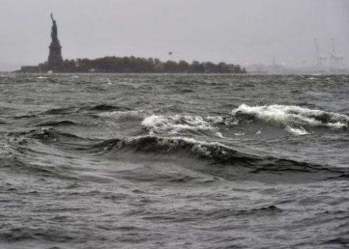 High surf on the Hudson River is seen near the Statue of Liberty on October 29, 2012, as New Yorkers brace for Hurricane Sandy