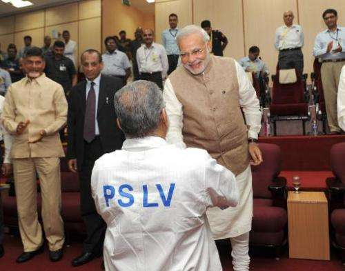 In a photo released by the Press Information Bureau (PIB) on June 30, 2014, Indian Prime Minister Narendra Modi (R) congratulate