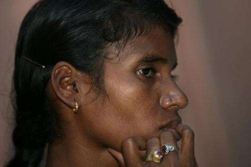 Indian villager Phulme Majhi gestures as she attends a press conference in New Delhi to highlight the environmental impact on he