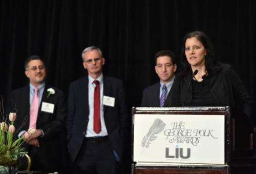 Laura Poitras (R) and Glenn Greenwald (2nd R) with The Guardian's Ewen MacAskill (2nd L) and Barton Gellman (L) of The Washingto