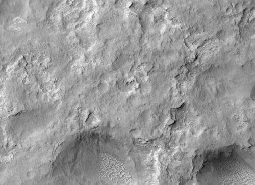Mars orbiter images rover and tracks in Gale Crater
