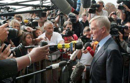 Max Mosley answers journalists' questions as he leaves FIA headquarters in Paris on September 21, 2009