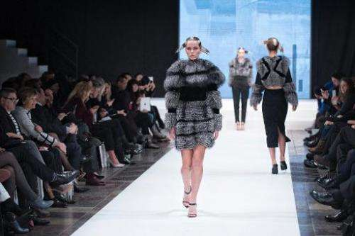 Models presents creations from the Autumn/Winter 2014 collection by Kopenhagen Fur house during the Copenhagen Fashion week, in