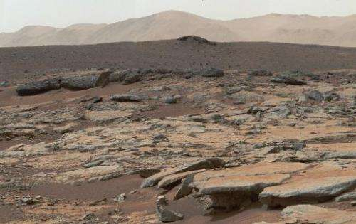 Mosaic of images from NASA's Curiosity Mars rover released December 9, 2013 shows a series of sedimentary deposits in the Glenel